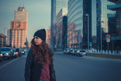 Beautiful girl posing in an urban context Stock Photo