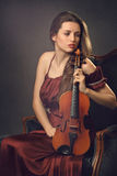 Beautiful girl posing with a violin Stock Photo