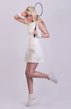 Beautiful girl posing in white dress in the studio Royalty Free Stock Images