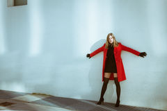 Beautiful Girl Posing With Red Coat Stock Photo