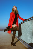 Beautiful Girl Posing With Red Coat Stock Photos