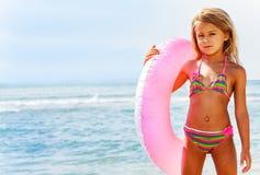 Free Beautiful Girl Posing With Swim Ring On The Beach Stock Photos - 131411643