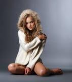Beautiful girl posing in woolen jacket with hood Stock Images