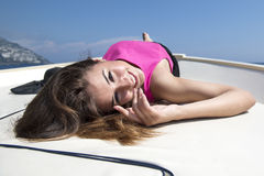 Beautiful girl in Positano on the Amalfi posing on the boat Royalty Free Stock Images