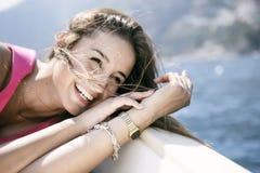 Beautiful girl in Positano on the Amalfi posing on the boat Stock Photo