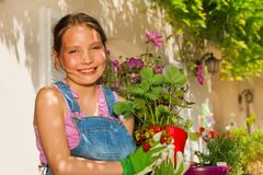 Beautiful girl with potted strawberries plants stock images