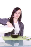 Beautiful Girl Pouring Milk to her Cereal Royalty Free Stock Images