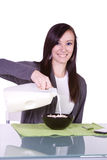 Beautiful Girl Pouring Milk to her Cereal Royalty Free Stock Image