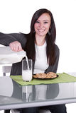 Beautiful Girl Pouring Milk to her Glass Stock Images