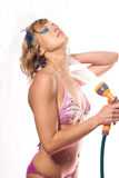 Beautiful girl pours water from shower Stock Photo