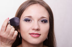 Beautiful girl powder applied to the face Royalty Free Stock Image