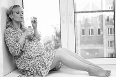 Pregnant girl black and white stock photography