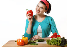 Beautiful girl is preparing to eat. Fresh vegetables. Salad vege Royalty Free Stock Photography