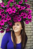 Beautiful girl in pretty hat from flowers Stock Image