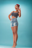 Beautiful girl with pretty smile in pinup style Stock Photo
