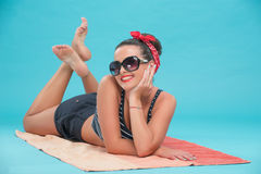 Beautiful girl with pretty smile in pinup style on Royalty Free Stock Image