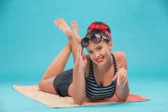 Beautiful girl with pretty smile in pinup style on Stock Images
