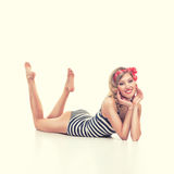 Beautiful girl with pretty smile in pinup style Stock Photography