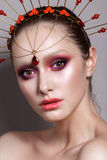 Beautiful girl with professional color makeup and indian head accessory Royalty Free Stock Photo