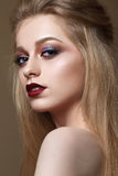 Beautiful girl with professional colorful makeup stock photo