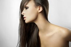 Beautiful girl in profile with long hair Stock Photography