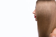 Beautiful girl in profile with a perfectly smooth hair. royalty free stock image