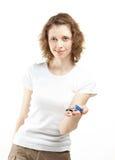 Beautiful girl proposing keys Stock Photo