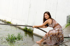 Beautiful girl pulling a rope Stock Photography