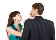 Beautiful girl pulls the nose businessman Royalty Free Stock Image