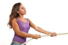 Beautiful girl pulls a rope Royalty Free Stock Photos