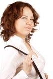 Beautiful girl pulls suspenders Royalty Free Stock Image