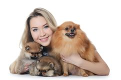 The beautiful girl with a puppy spitz Royalty Free Stock Photo