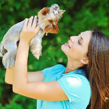 Beautiful girl with puppy yorkshire terrier Stock Photos