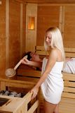 Beautiful girl enjoying in the sauna Stock Photography