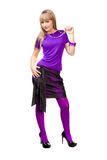 Beautiful girl in purple clothes. With silver necklace and black shoes stock photo