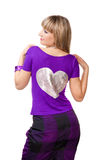 Beautiful girl in purple clothes with big silver h. Eart on her back on white backround stock photo