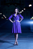 Beautiful girl in purple coat Stock Photos
