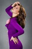 Beautiful girl in purple dress. Studio shot Stock Image