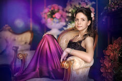 Beautiful girl in a  purple dress Royalty Free Stock Photo