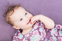 Beautiful girl in a purple dress Royalty Free Stock Image