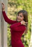 Beautiful girl in purple dress outside steel wall Royalty Free Stock Photos