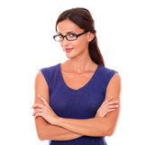 Beautiful girl in purple dress and spectacles. Looking at you in white background Royalty Free Stock Photography
