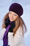 Beautiful girl in a purple knitted winter hat and scarf Stock Photo