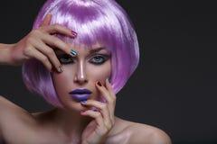 Beautiful girl in purple wig Royalty Free Stock Photo
