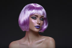 Beautiful girl in purple wig Stock Images