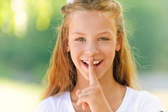 Beautiful girl puts forefinger Stock Photo