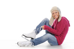 Beautiful girl puts on skates Stock Photography