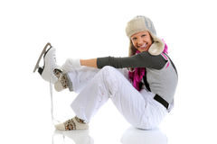 Beautiful girl puts on skates Stock Photo