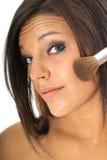 Beautiful girl putting on makeup Royalty Free Stock Image