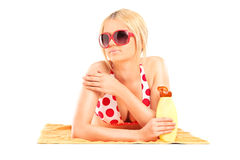 Beautiful girl putting on sunscreen Royalty Free Stock Photo